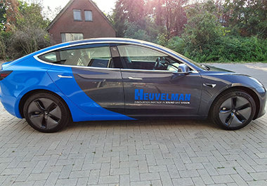 Autobelettering Tesla 3 firma Heuvelman